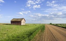 Rural scene. Farmers shed in the fields along side a gravel road stock photography