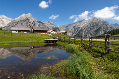 Rural scene in Alps with a lake in the foreground. Austria, Walderalm Royalty Free Stock Images
