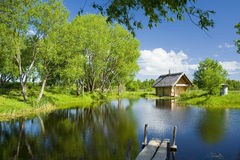 Rural scene with bath house. Rural scene with pond, bath house and footbridge Royalty Free Stock Photos