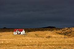 Rural scene in Iceland. Open landscape with a small house in rural Iceland in winter Stock Images