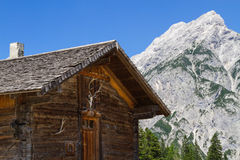 Rural Scene with Mountain Range and old Alpine Hut Royalty Free Stock Photo