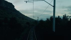 Rural scene through the passenger train window. Travelling by passenger train in the morning, view from the rear of train stock footage