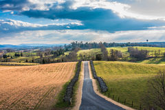 Road Through Autumn Fields and Rolling Hills at Antietam Stock Photos