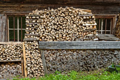 Rural scene with stacked firewood in a mountain hut Royalty Free Stock Photo
