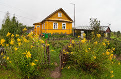Rural scene with wooden house Stock Photos