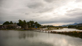 Rural scenery in Phan Rang, Vietnam. Rural scenery with a bridge on lake at sunset in Phan Rang, Vietnam Royalty Free Stock Image