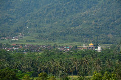 Rural scenery in Yogyakarta, Indonesia. Small village with a mosque at green valley in Yogyakarta, Indonesia Stock Photography