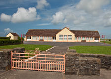 Rural school building on a sunny day Stock Images