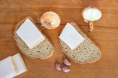 Rural simple and nutritious food: bread, lard, onions and garlic stock images