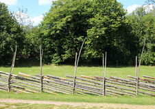 Rural simple wooden fence at hay field Stock Images