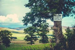Rural Slow Sign. Rustic Slow Sign Nailed To A Tree In The Scottish Countryside stock photography