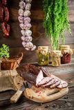 Rural smokehouse ham preparation for smoking. On old wooden table Royalty Free Stock Photo