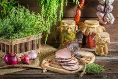 Rural smokehouse ham preparation for smoking Royalty Free Stock Images