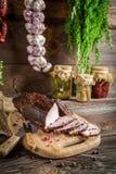 Rural smokehouse ham preparation for smoking Stock Images
