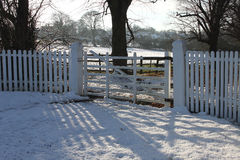 Rural snowscape with old gate Stock Photography