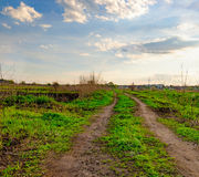 Rural spring landscape with dirt road in Ukraine Royalty Free Stock Photography