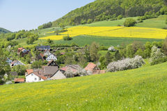 Rural springtime scenery. Sunny illuminated idyllic rural springtime scenery in Hohenlohe, a district in Southern Germany Royalty Free Stock Image