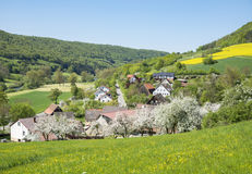 Rural springtime scenery. Sunny illuminated idyllic rural springtime scenery in Hohenlohe, a district in Southern Germany Stock Image
