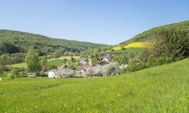 Rural springtime scenery. Sunny illuminated idyllic rural springtime scenery in Hohenlohe, a district in Southern Germany Stock Photo