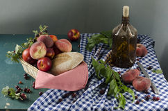 Rural still life with ripe peaches Royalty Free Stock Image