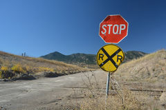 Rural Stop Sign and Dirt Road Railroad Crossing in the Mountains Stock Photography