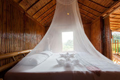 Rural style bedroom with canopy bed , bamboo decorated. Very pop Royalty Free Stock Image