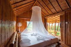 Rural style bedroom with canopy bed , bamboo decorated. Very pop Royalty Free Stock Images