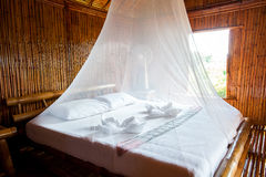 Rural style bedroom with canopy bed Stock Photography
