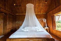 Rural style bedroom with canopy bed Royalty Free Stock Photo