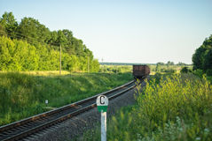 Rural summer landscape with freight train. Hauled by two diesel locomotives Stock Photo