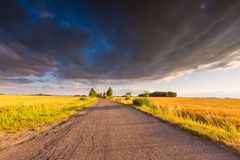Rural summer landscape with old asphalt road Royalty Free Stock Photography