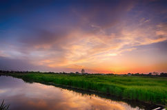 Rural summer sunset. Landscape with river and dramatic colorful sky Royalty Free Stock Photos
