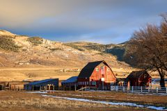 Rural sunset with a red barn and american flag, Utah, USA. Stock Photos