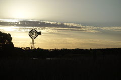 Rural sunset. Sunset on windmill silhouette on a rural property Royalty Free Stock Photos