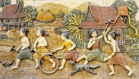 Rural thai's life stone mural. Royalty Free Stock Image