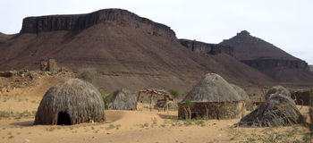 Rural Thatch Huts. Thatch huts of Terjit Village below Adrar mountains, Mauritania royalty free stock images