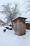 Rural toilet and dog in winter Stock Image