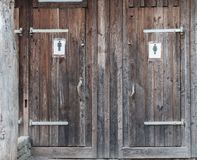 Outhouse for man and woman royalty free stock photography
