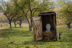 Rural toilet. Wooden rural toilet at the back of the garden Stock Photo