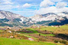 Rural tourism at Basque Country fields, Spain. Countryside town located at Basque Country in Aramaio valley, Spain Royalty Free Stock Image