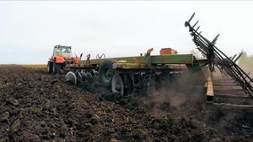 Rural Tractor Cultivating Soil Of Agricultural stock video