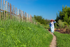 Rural Trail along wooden Fence and Person walking Royalty Free Stock Images