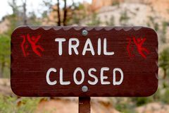 Rural TRAIL CLOSED sign made of lacquered wood Royalty Free Stock Photos