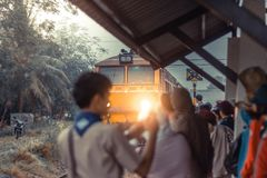 Rural train station in the morning. Selective focus on locomotiv royalty free stock images