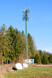 Rural Transmission Tower. A multi-receiver and sending transmission tower in a rural setting stock image