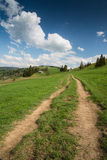 Rural trekking road in polish mointains Stock Images