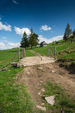 Rural trekking road in polish mointains Royalty Free Stock Images