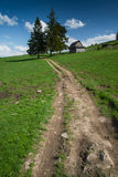 Rural trekking road in polish mointains Stock Photos