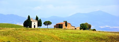 Rural Tuscan church and house. Tuscany, Italy panorama with tiny chapel and house among hills Royalty Free Stock Photography