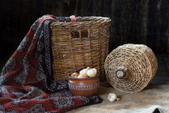 The rural utensils. Still-life with a basket and rural utensils Stock Photos